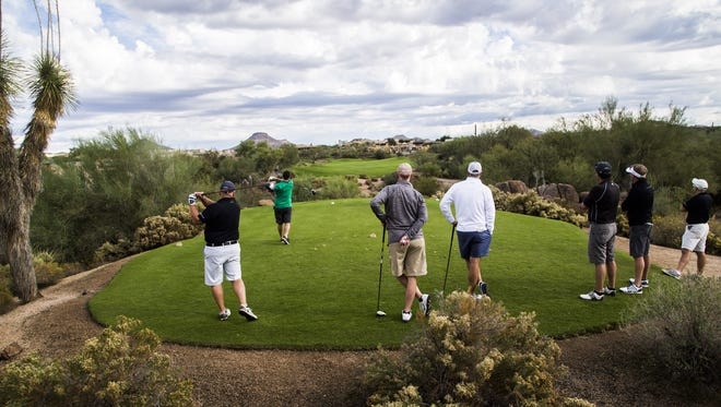 Golfers take to the first tee to start a round at Troon North Golf Club in North Scottsdale on Nov. 4, 2016.
