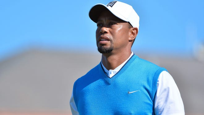 Tiger Woods is pictured playing at The Farmers Insurance Open at Torrey Pines.