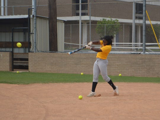 ASH senior shortshop Taryn Antoine takes batting practice