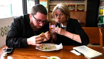 Chef Kenny West, left, and Northjersey.com food writer Esther Davidowitz try tacos at Tacos Matamoros on Parker avenue in Clifton, NJ on Thursday, November 1, 2017.