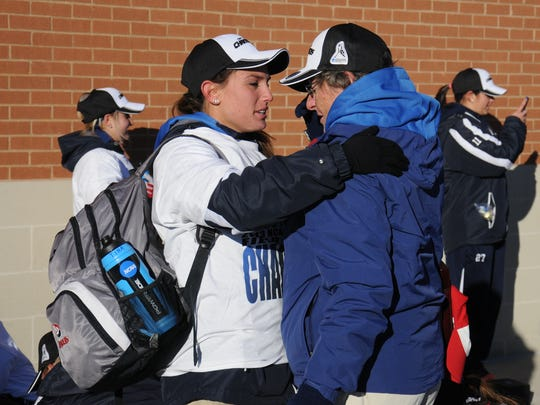 Amanda Strous (left) pulls Shippensburg coach Bertie Landes in for a hug after the 2013 National Championship game. Landes retired on July 31, 2017 after 18 years at SU.