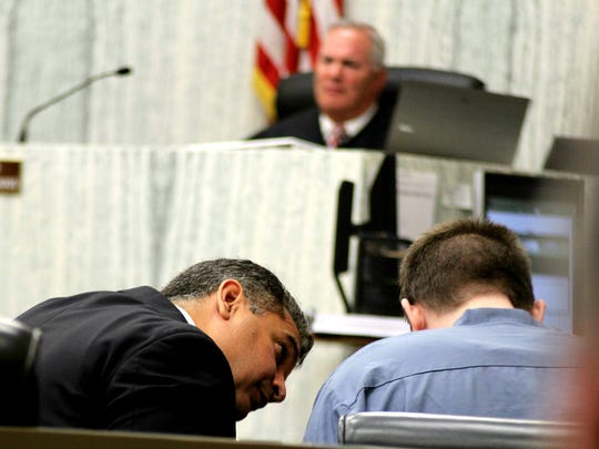 Defense Attorney Christopher Oram comforts James Biela during closing arguments at a hearing on Thursday in Washoe County District Court.