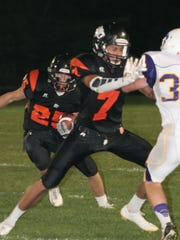 Grinnell's Joe Rivera, 7, seen here blocking, was named to the Class 3A first team All-State squad as a punter.