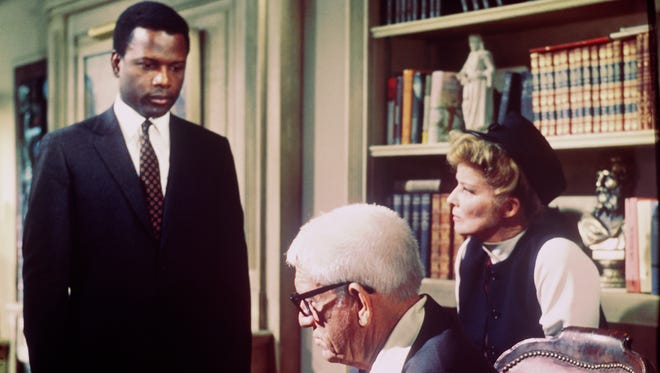 "Sidney Poitier informs Spencer Tracy and Katharine Hepburn that he plans to marry their daughter in ""Guess Who's Coming to Dinner."""