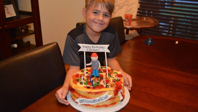 Carson Boutte with his pizza cake.