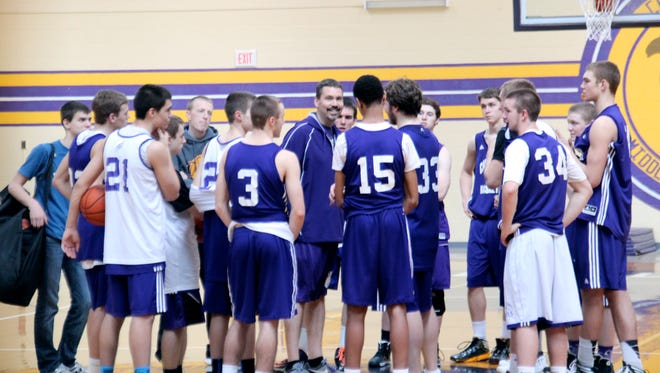 Head coach Aric Russell addresses the Campbell County High School boys' basketball team after practice March 14, 2014.