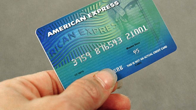 This Nov. 16, 2008, file photo shows an American Express credit card. Police in Ocala, Fla., are searching for a woman who used a stolen American Express card after a suspicious store clerk snapped a photo of her posing with it.