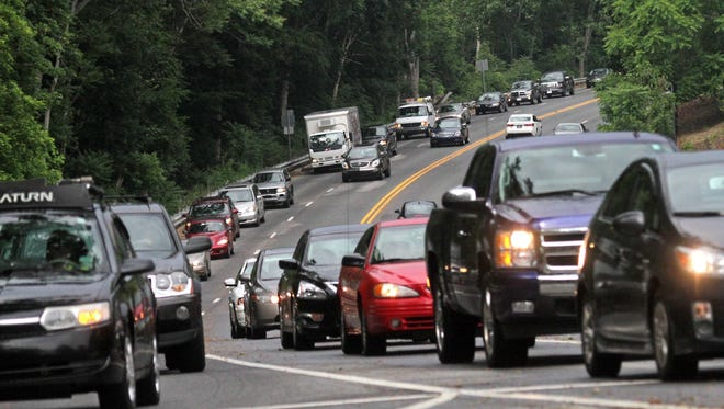 Traffic starts to back up in the southbound lanes of Del. 141 near the Tyler McConnell Bridge around 3:45 p.m., Tuesday, June 3, 2014.