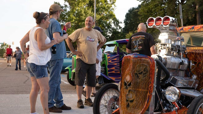 Dave Varner, right, chats about his car Saturday evening during the 2020 Homestead Assisted Living Cruisin' the Capitol Car Show at the Kansas Statehouse.