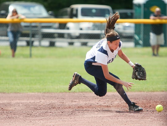 Pine Plains' Tia Fumasoli chases down a grounder during