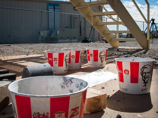 Empty KFC buckets are used as containers to make simulated asteroids at the solar furnace asteroid mining tests at White Sands Missile Range. A simulated asteroid, a grey half-cylinder, can be seen behind the KFC bucket on the left.