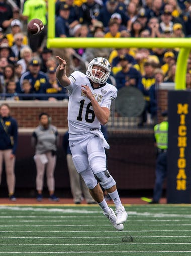 Western Michigan quarterback Jon Wassink throws a pass in the first quarter of an NCAA college football game against Michigan in Ann Arbor, Mich., Saturday, Sept. 8, 2018. (AP Photo/Tony Ding)