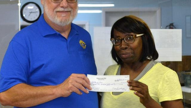 Carleen Mckinley, right, executive director of the Shelter of Love, accepts  a check from Durbin Council Knights of Columbus Grand Knight Matt Ciecorka at the September 8 Council meeting.  The check was  for some $1,200-the money raised by the Council it its Baby Bottle Campaign.  Mrs. McKinley told the Knights that the Shelter had sold its  building in the 100 block of  West Main because of the excessive cost of maintenance and will soon locate to a home near the intersection of East Lyon St and North Brady St.  The Shelter  provides Pro Lie pregnancy services for Union County residents.