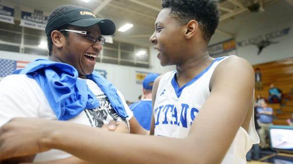 Isaiah Burch, left, and Divese Carson celebrate McDowell's win over Erwin in the MAC championship game February 17, 2017.