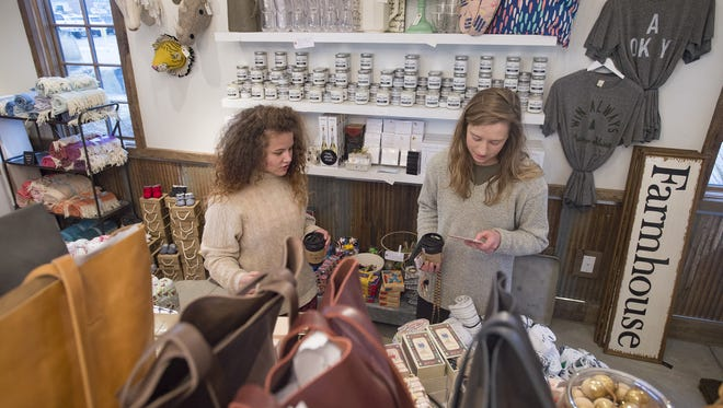 Jessamine Hamer and Rachael Stark browse the shelves at Knapsack on Friday, November 17, 2017. The store, located at Jessup Farm, features local nicknacks and trinkets for holiday shopping.