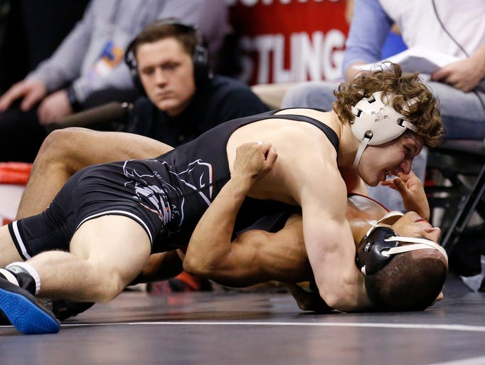 Oklahoma State's Alex Dieringer, top, wrestles Boston's Nestor Taffur, right, in a 157-pound match in the quarterfinals of the NCAA Division I wrestling championships in Oklahoma City, Friday, March 21, 2014. Dieringer won the match.