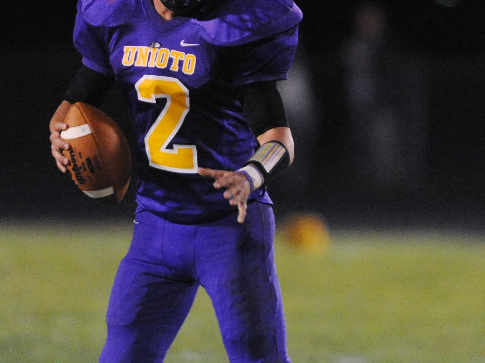Unioto's Clay Edler looks to pass during last week's game against Piketon. Edler was honored with the Week 9 Player of the Week award by the Gazette's online voters.