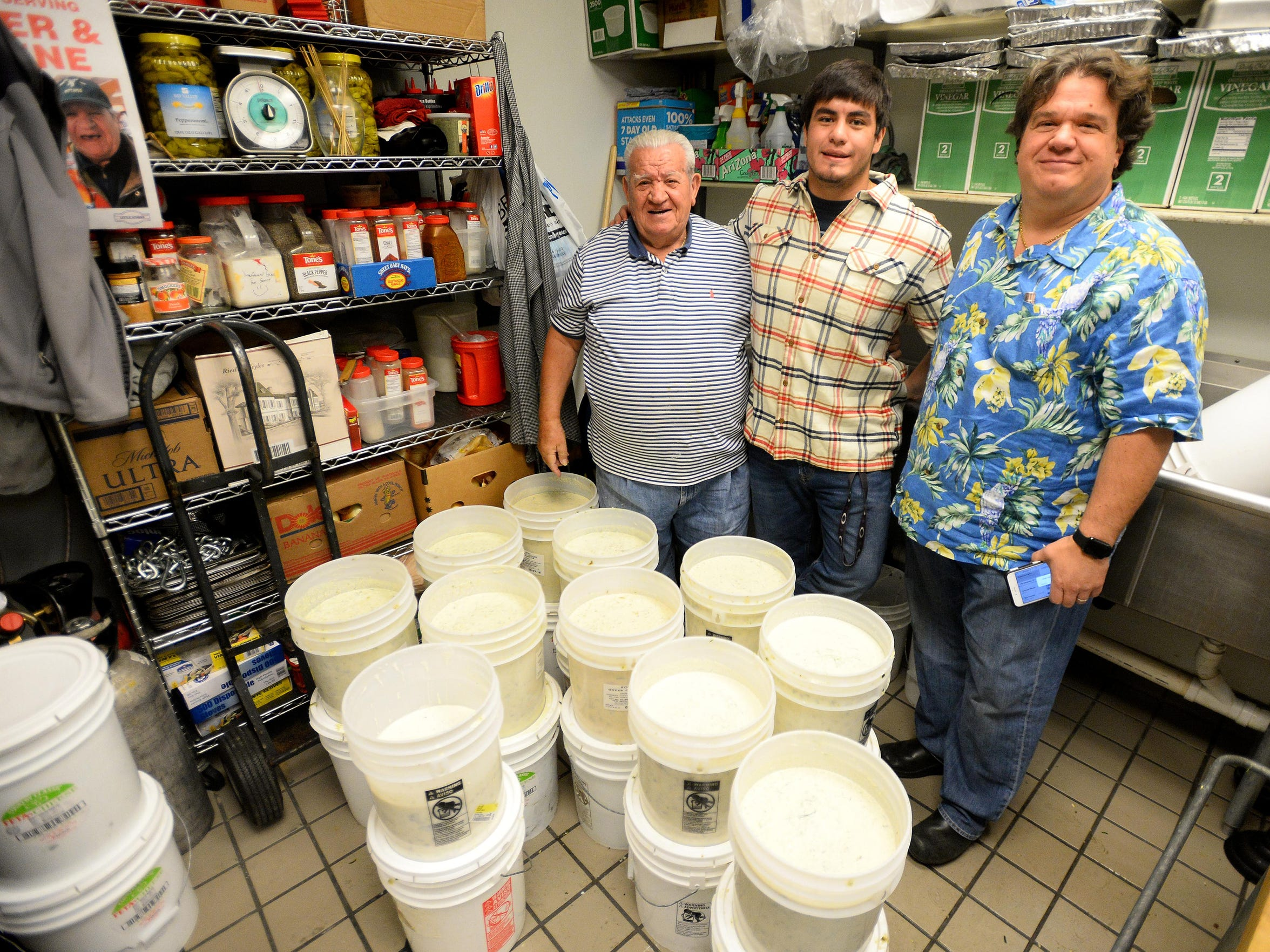 """Andreas """"Andy"""" Geranios, left, started Little Athens restaurant with his wife Aspasia in 1980. He still makes the tzakziki sauce. His son Nick, right, manages the Holiday Village Mall shop now, while his grandson Andreas, center, is pushing effort to add a retro speakeasy bar."""