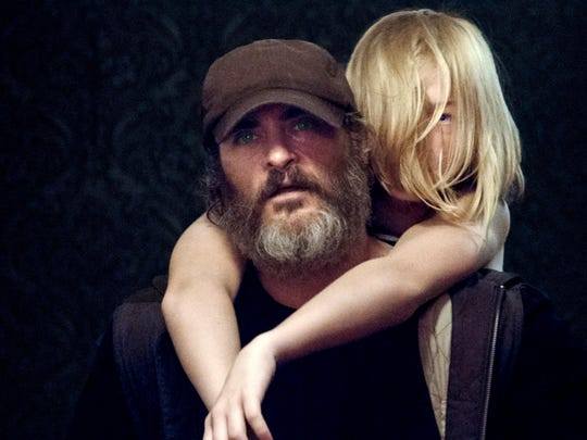 """Tormented hitman Joe (Joaquin Phoenix) is hired to rescue a kidnapped girl (Ekaterina Samsonov) in """"You Were Never Really Here."""""""