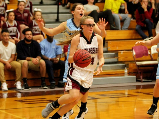 Senior Bria Crompton drives along the baseline for 2 of her 6 points in the Warlassies' fourth straight victory.