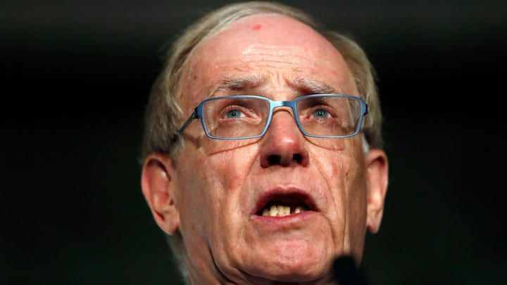 FILE- In this Friday Dec. 9, 2016 file photo, World Anti-Doping Agency investigator Richard McLaren speaks during a press conference in London. The Canadian lawyer who investigated the state-backed doping scheme by Russia when it hosted the 2014 Winter Olympics said in an interview with the Associated Press that the World Anti-Doping Agency rushed into accepting a bad deal by reinstating the country's drug-testing program. (AP Photo/Kirsty Wigglesworth, File)
