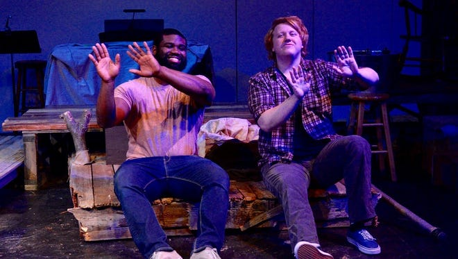"""Jim (Michael Kately, left) and Huckleberry Finn (Corey Rauscher) float down the Mississippi River in Tony Award-winning musical """"Big River: The Adventures of Huckleberry Finn,"""" which opens 7:30 p.m. Feb. 17 at Backdoor Theatre."""