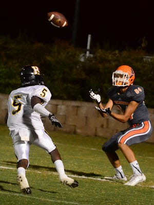 Beech junior Ty Moore catches a touchdown pass as Hendersonville junior Xavier Fitts closes in during fourth-quarter action. The Buccaneers defeated Henderonville 24-23 on Friday evening.