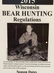 Lynaya Spang of De Pere is the cover girl on the 2015 Wisconsin Bear Hunting Regulations pamphlet.