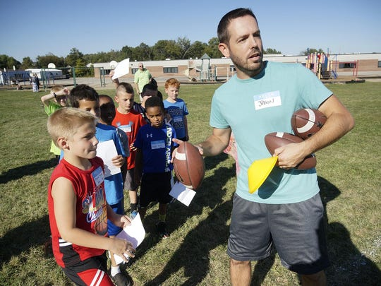 Jason Lombardo of Canton Leisure Services explains the passing drill to the kids.