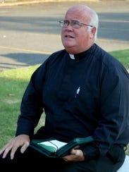 The Rev. James Brady, pastor of St. Landry Catholic
