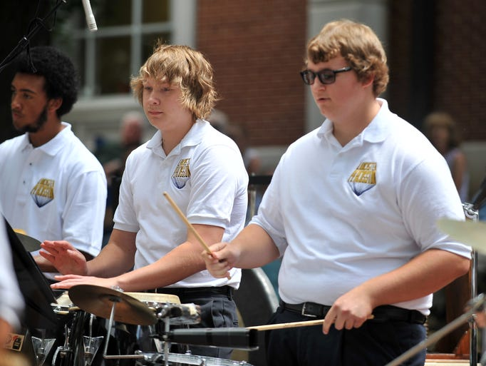 Brandon Burris, left, and Clark Hubbard, right, perform with the Lancaster High School Percussion Ensemble performance Friday, July 25, 2014, in downtown Lancaster. The ensemble performed as part of the Lancaster Festival's midday entertainment at the downtown bandstand.
