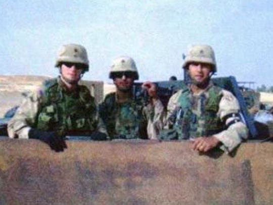Attorney Linden Barber, managing partner of the Indianapolis office of Quarles & Brady, is shown at the far left in 2004, while working as a judge advocate advising U.S. soldiers in Iraq on the rules of engagement and other matters.