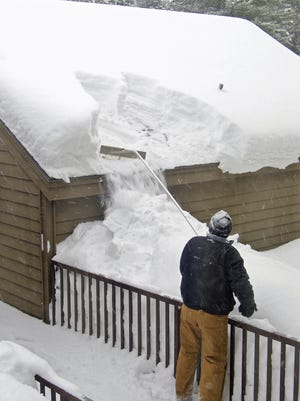 Buy yourself a snow roof rake and every time it snows, pull the snow off the edge of the roof.