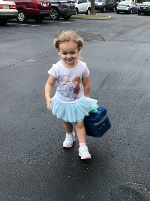 Isabella wanted to be helpful so she asked if she could carry her father's lunch box. He happily let her.