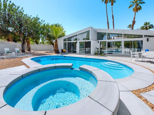 During the home's remodel, its pool was expanded and a waterfall spa was installed.