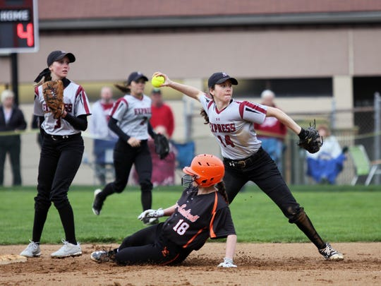Elmira shortstop Danielle Dille throws to first base as Katelynn Yanowiak slides into second for Union-Endicott on Thursday during the Express' 8-1 victory at Ernie Davis Academy.