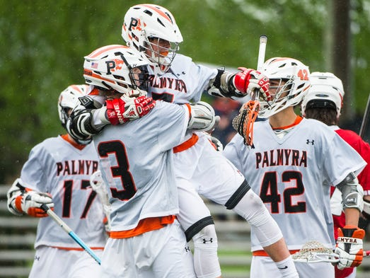 Palmyra's Ethan Fain hugs his teammate Kyle Nolen after
