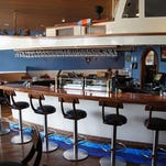Swan River's renovations include a raw bar in the main dining room that looks like a lobster boat.sharon kenny/special to the news-press