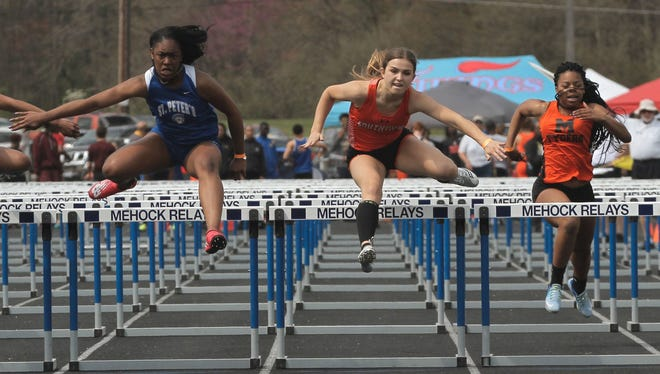 St. Peter's Alysse Wade wins the 100 hurdles in the 2017 Mehock Relays. Mansfield Senior's Alaya Grose (far right) was fourth in that dual of the area's two top hurdlers.