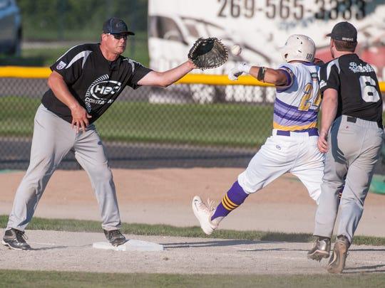 Battle Creek HBC first baseman Dave Larson catches