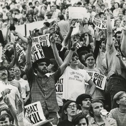 NEWS SENTINEL ARCHIVE In a May 28, 1970, photograph, President Richard Nixon is protested during evangelist Billy Graham's East Tennessee Crusade at Neyland Stadium.