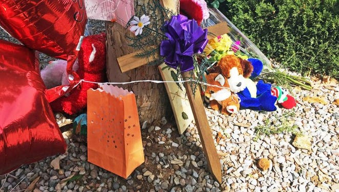 A memorial for 10-year-old Victoria Martens, who police said was sexually assaulted, strangled then dismembered is seen at an Albuquerque apartment building Thursday, Aug. 25, 2016.