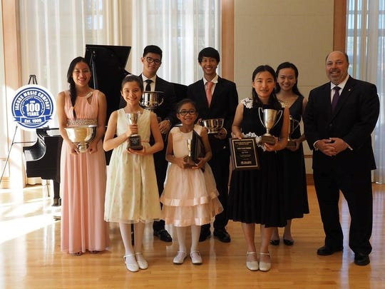 2016 Piano Competiton for Young Artist Winners:  (L to R) Mia Huang, Petrina Steimel, Stephen Joven-Lee, Isabella Florendo, Kyle Huang, Angeline Ma and Linsy Wang. Randy Brown from Jacobs Music Company presented the awards.