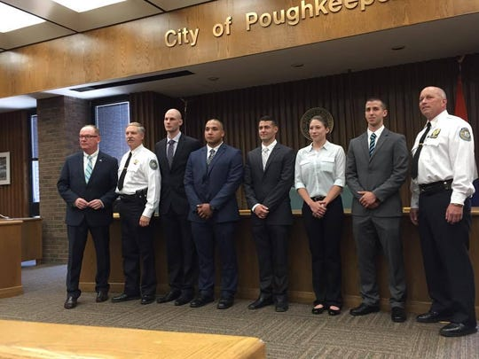 The five new officers pose for a photo with the police chief and mayor. There have been 11 officers sworn in since the beginning of 2016.