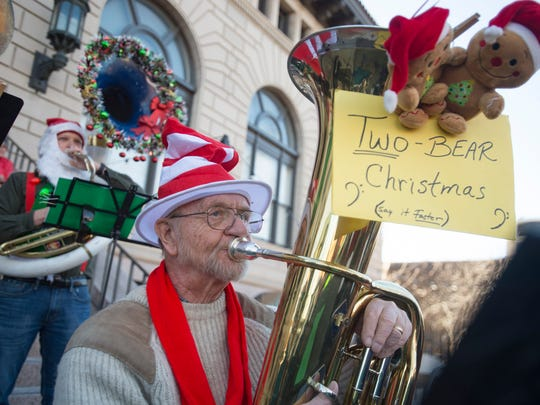 Rod Christian and nearly 100 other musicians perform a classic Christmas carol during Tuba Christmas in Oak Street Plaza on Saturday, December 9, 2017. A crowd filled the plaza to watch and sing along at the event, in its twelfth year in Fort Collins.