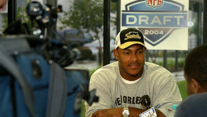 Smith was the No. 18 overall pick by the Saints in the 2004 NFL draft.