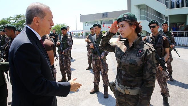 A handout picture provided by the Turkish President Press office shows Turkish President Recep Tayyip Erdogan visiting the Turkish police special forces headquarters, in Ankara, Turkey, on July 29, 2016.