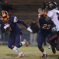 Escambia High running back Jabir Frye looks for a clear route to run the ball Friday night in a Region 1-6A quarterfinal against Navarre. The Raiders came back to defeat the Gators 44-30.