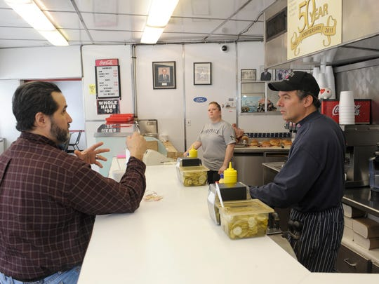 Lile's Sandwich Shop owner Harry Lile, right, chats with customer Arnulfo Cantu Jr. of Detroit. The shop's ham sandwiches are a local staple.