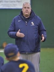 Emphasizing a team-first mentality during Wednesday's practice is Schoolcraft College head baseball coach Rob Fay, formerly of Dearborn Edsel Ford.
